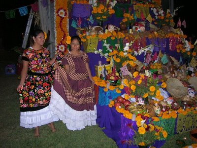 Two women by a personal family altar