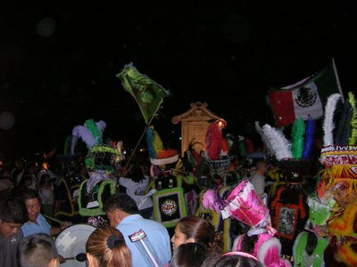 Oaxacan dancers perform at the entrance to the cemetery